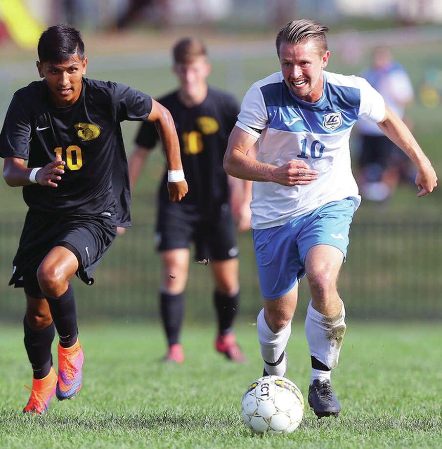 Lewis & Clark's Lochlan Reus, right, drives the ball upfield as he is trailed by Parkland's Alex Zarco during Saturday's match at LCCC's Soccer Stadium in Godfrey. Photo: Billy Hurst | For The Telegraph