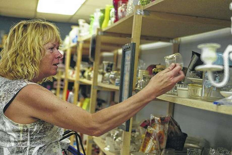 Lori Blue of Jacksonville looks at items at Matthew 25 Thrift Store at the GO Church on Thursday. Photo: Samantha McDaniel-Ogletree | Journal-Courier