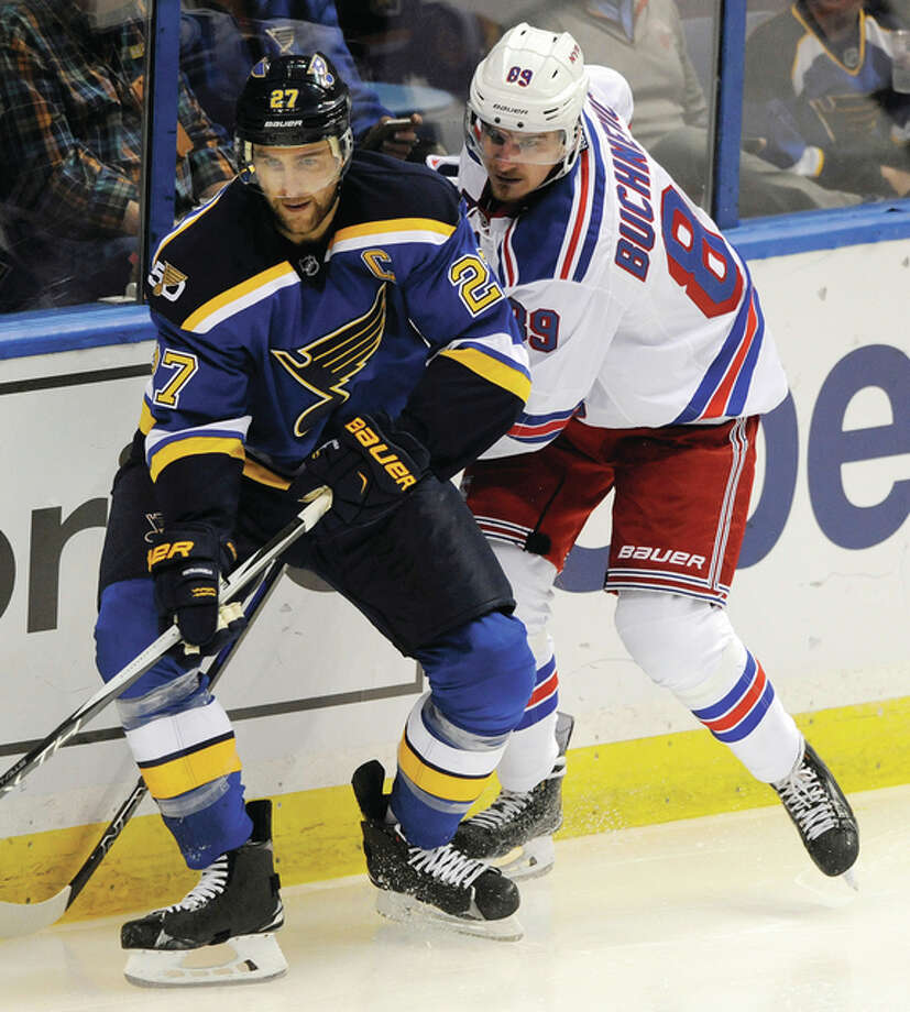 The Rangers' Pavel Buchnevich (right) and the Blues' Alex Pietrangelo look for the puck during the second period of the Blues win Saturday night in St. Louis. Photo: Associated Press