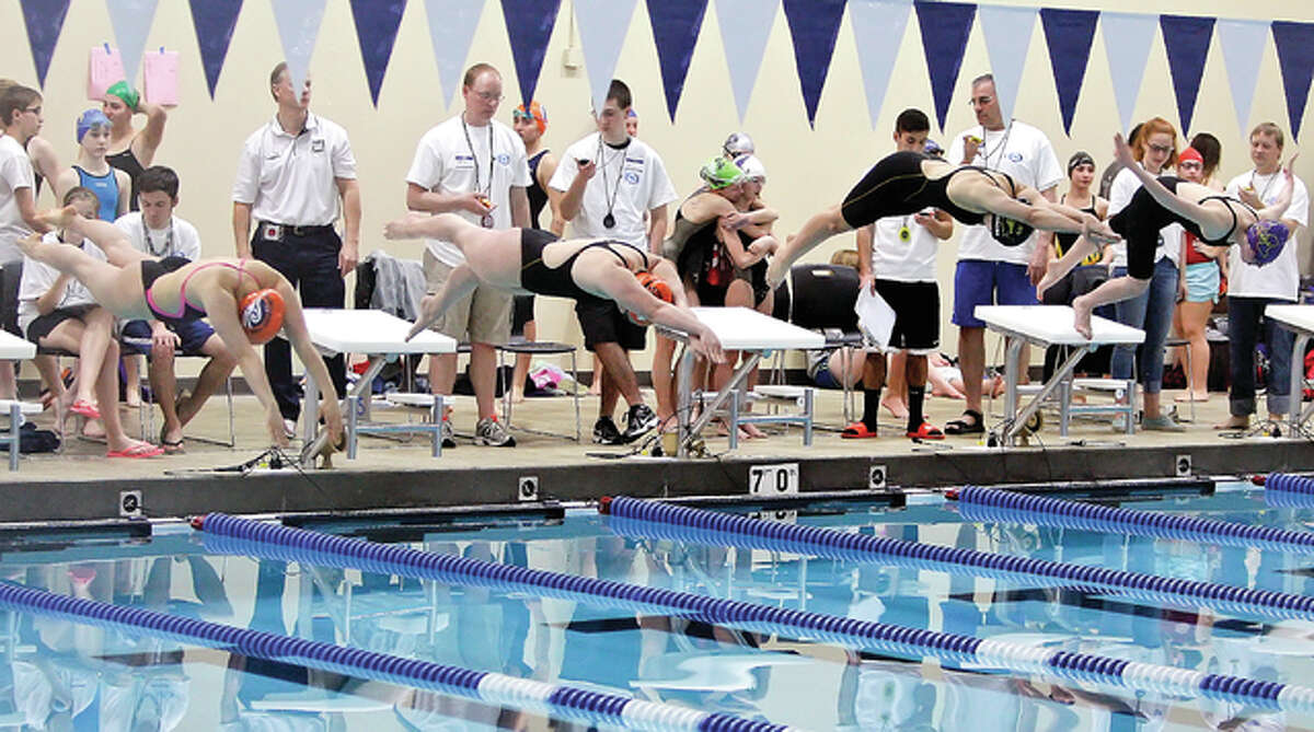 Swimmers hit the water at the chuck Fruit Aquatic Center. Edwardsville High finished first in Saturday's Swim For Hope meet at the CFAC.