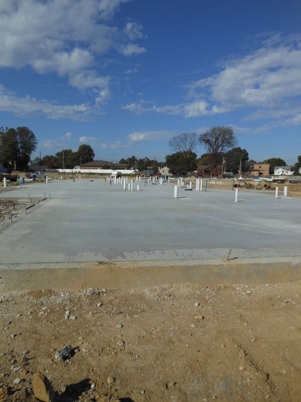 A concrete pad awaits construction workers from Morrissey Construction Co., of Godfrey, on which to build one of 13 apartment buildings at Madison County Housing Authority's former Northgate complex, to be called Woodland Park apartments.