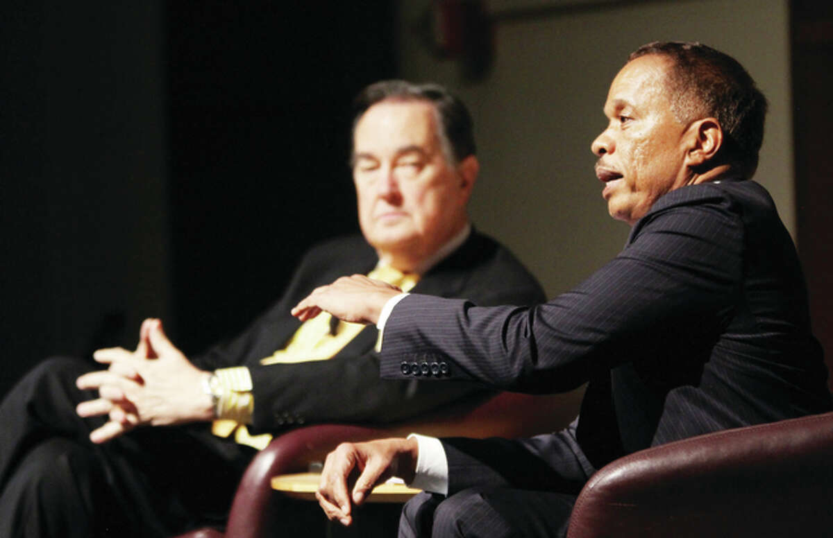 """Juan Williams, right, makes a point while Cal Thomas watches during """"Crossroads: A Conversation About America's Future,"""" recently at Southern Illinois University Edwardsville."""