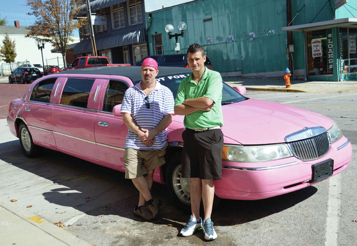 Guerino Bartello, left, is holding the First Annual Breast Cancer Awareness Auction in honor of Alice Bartello with assistance from Kyle Aulabaugh, right, who owns the pink stretch limousine that he regularly donates for use at breast cancer events.
