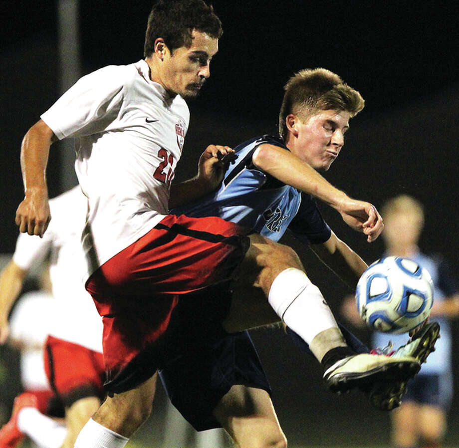 Highland's Evan Herman (left) battles Jersey's Gavin McGuire for control of the ball during the semifinals of the Jacksonville Class 2A Regional Tuesday night at Alumni Field in Jacksonville. Photo: Dennis Mathes, Journal Courier | For The Telegraph