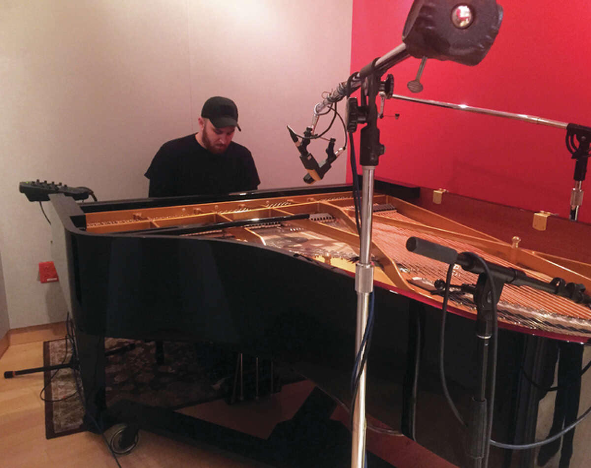 Tim Haar plays piano, keyboards, and bass guitar in SEANCE.