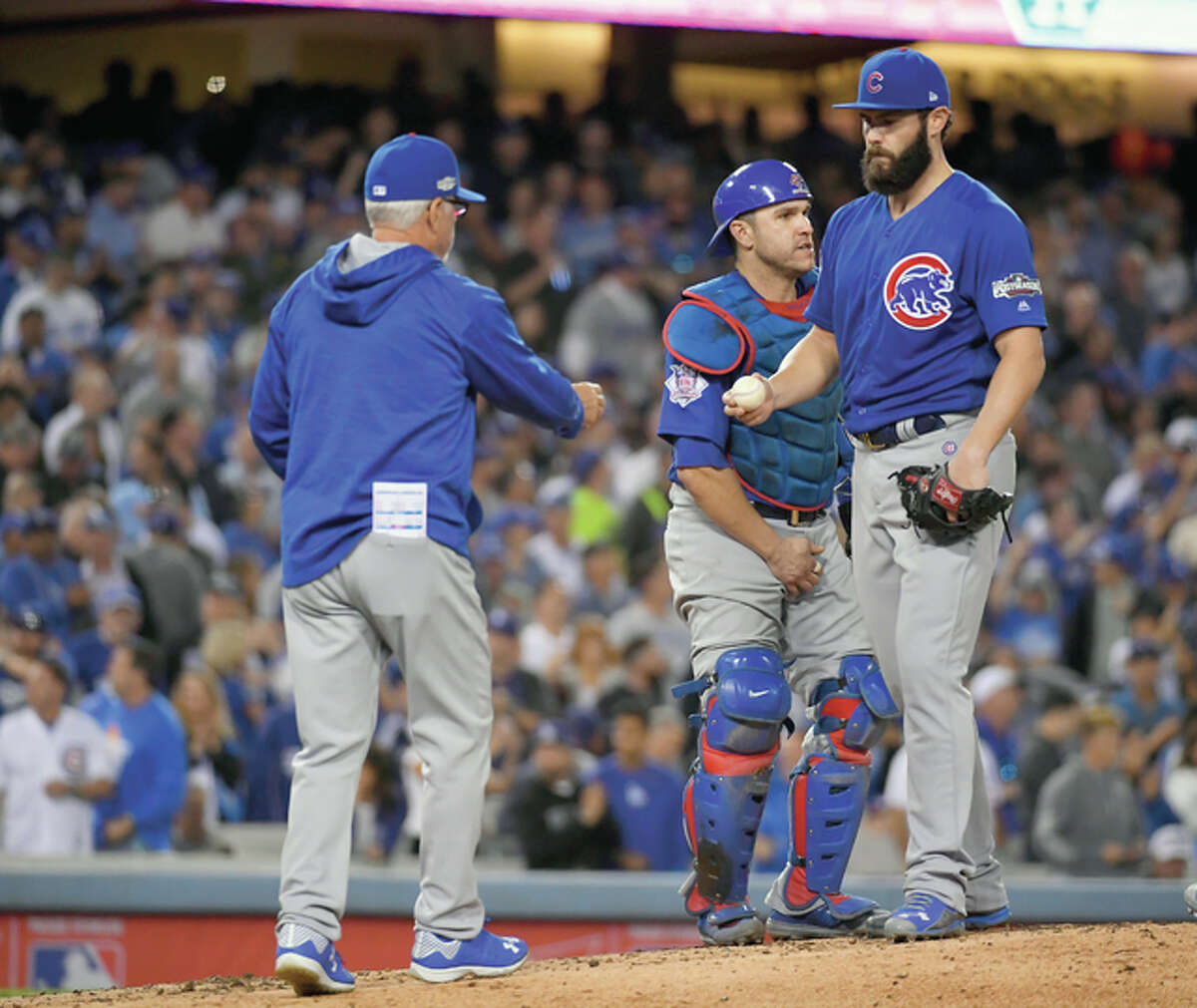 Chicago Cubs manager Joe Maddon takes starter Jake Arrieta out of the game during the sixth inning of Game 3 of the National League Championship Series against the Dodgers Tuesday night in Los Angeles.