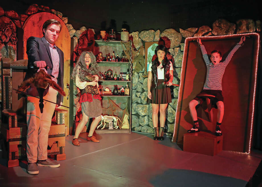 In the dungeon, Wednesday (Kate Costello), second from right, teases her brother Pugsley (Lorian Warford), far right, while Lucas (David Bishop), far left, and Grandma (Christen Ringhausen) are up to their own shenanigans. Photo: Pete Basola/For The Telegraph