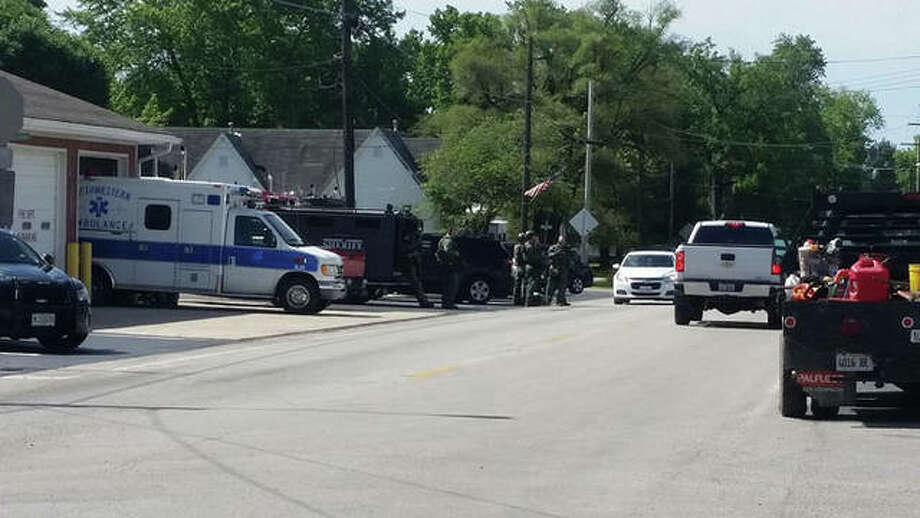 Police and SWAT team members gathered before responding to a house in Palmyra. Photo: Photo Courtesy Of John Mabus