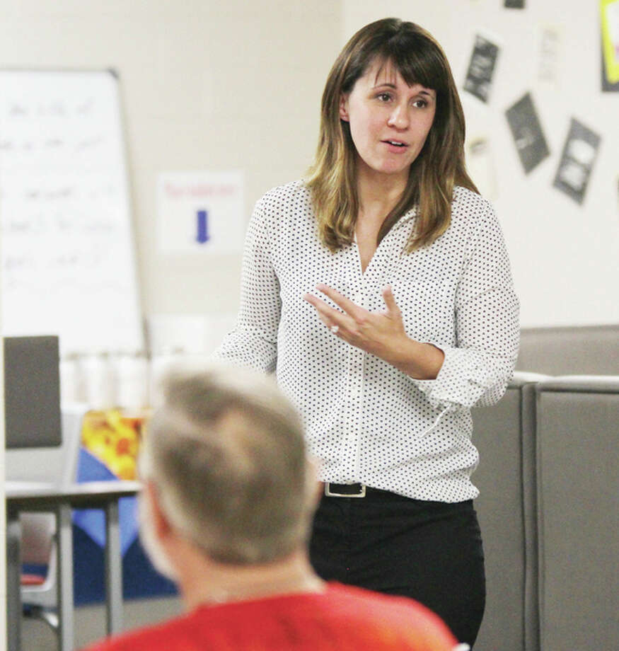 Katie Venverthloh, a prevention specialist with Chestnut Health Systems and the Lewis and Clark Area Youth Alliance coordinator, speaks at the start of a discussion about marijuana Wednesday evening at Roxana High School. Aaron Nyman, deputy director of the Metropolitan Enforcement Group of Southwestern Illinois, led the discussion, which included information about current trends.