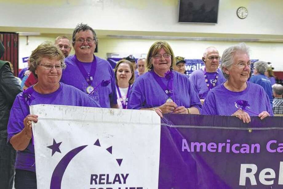 Caregivers and survivors walk during the 20th annual Relay for Life of Tri-County Friday at Jacksonville High School. Photo: Samantha McDaniel-Ogletree | Journal-Courier