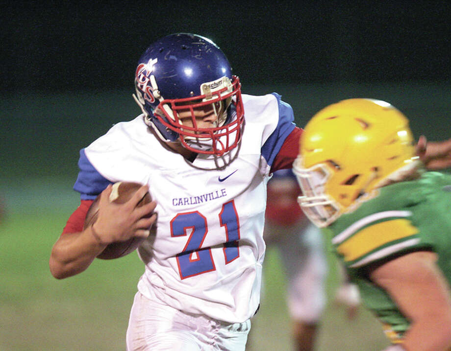 Carlinville's Jacob Dixon (21) ran for yards and broke the school single-season rushing record he set last in the Cavies' 65-10 South Central Conference victory over Litchfield Friday night. Dixon is pictured in earlier action at Southwestern. Photo: James B. Ritter File Photo | For The Telegraph
