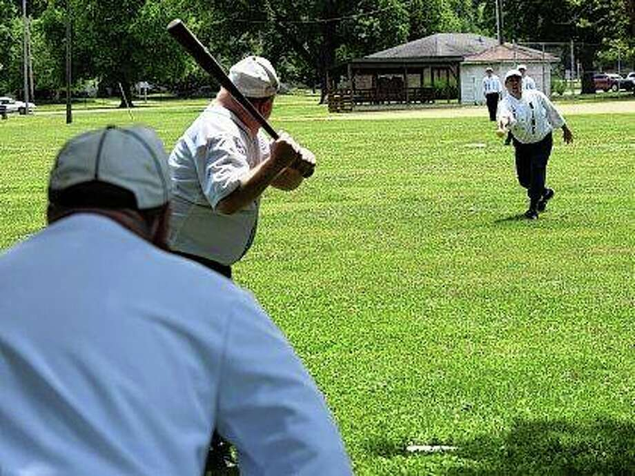 Players dressed in old-time uniforms play Saturday in the annual Vintage Base Ball Festival in Community Park. Photo: Greg Olson | Journal-Courier
