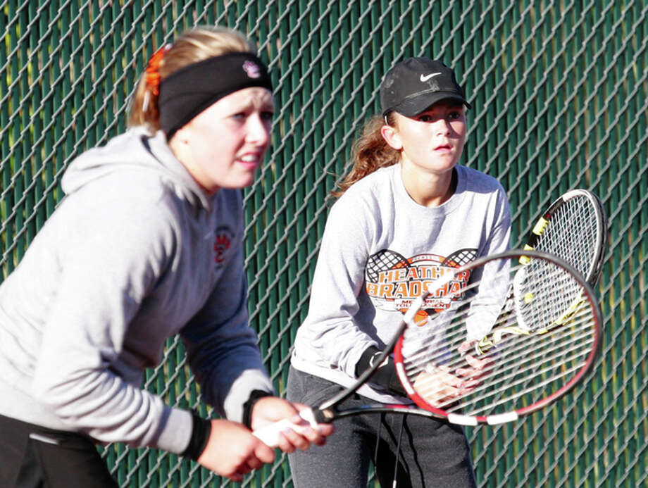 Edwardsville's Morgan Colbert, left, and Grace Desse finsihed their season in the IHSA Class 2A final four Saturday in Buffalo Grove. They dropped a semifinal match to eventual state champions Erika Oku and Megan Guenther of Hinsdale Central and fell in the third place match to Lincolnshire Stevenson's Gina Kondros and Elizabeth Ferdman. Photo: Telegraph File Photo