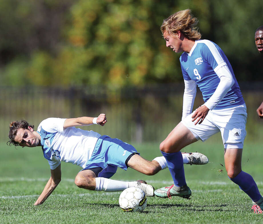 LCCC's Rhys Saunders, left, attempts a slide tackle against SWIC's Dakota Earnhart during Saturday's first-round game of the NJCAA Region 24 playoffs at LCCC's Soccer Stadium in Godfrey. Photo: Billy Hurst | For The Telegraph