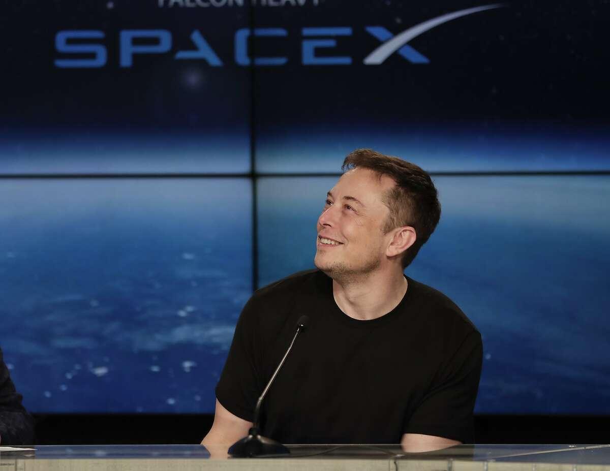 Elon Musk, founder, CEO, and lead designer of SpaceX, speaks at a news conference after the Falcon 9 SpaceX heavy rocket launched successfully from the Kennedy Space Center in Cape Canaveral, Fla., Tuesday, Feb. 6, 2018. (AP Photo/John Raoux)