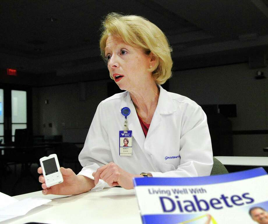 Nancy Ryan, a Greenwich Hospital registered dietitian and certified diabetes educator, holds a blood glucose meter used for measuring blood sugar at Greenwich Hospital, Greenwich, Conn., Thursday, Feb. 8, 2018. Photo: Bob Luckey Jr. / Hearst Connecticut Media / Greenwich Time