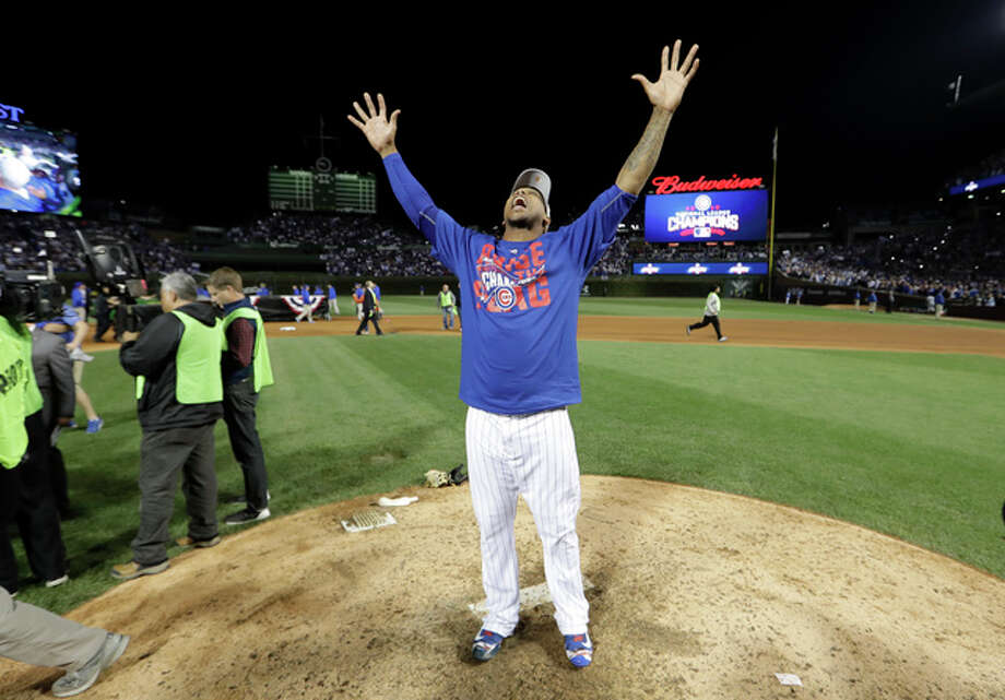 Chicago Cubs relief pitcher Pedro Strop celebrates after Game 6 of the National League Championship Series against the Los Angeles Dodgers, Saturday in Chicago. The Cubs won 5-0 to win the series and advance to the World Series against the Cleveland Indians. Photo: AP