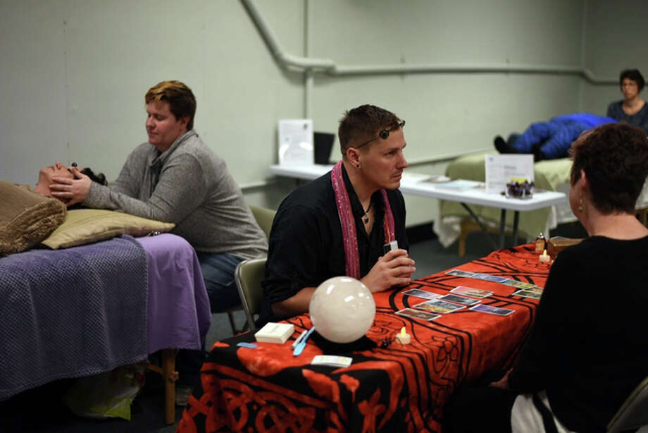Jeff Harris performs a Tarot reading Saturday at the second Psychic Fair held at Mystic Journeys.
