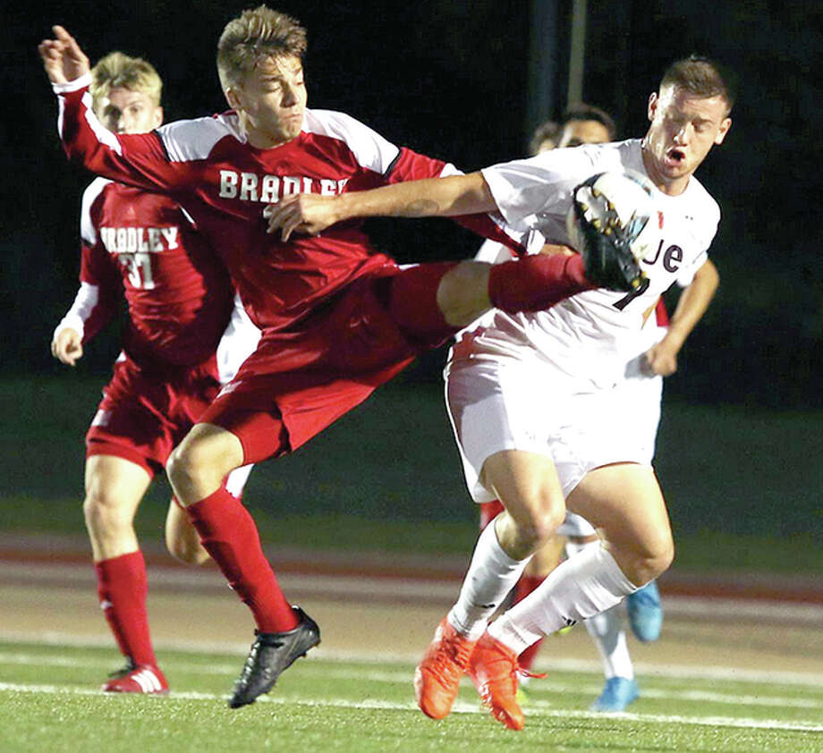 SIUE's Lachlan McLean, right, battles with Bradley's Clark Emerson in Missouri Valley Conference soccer action Saturday night at Korte Stadium. SIUE won, 3-1. Photo: SIUE Athletics