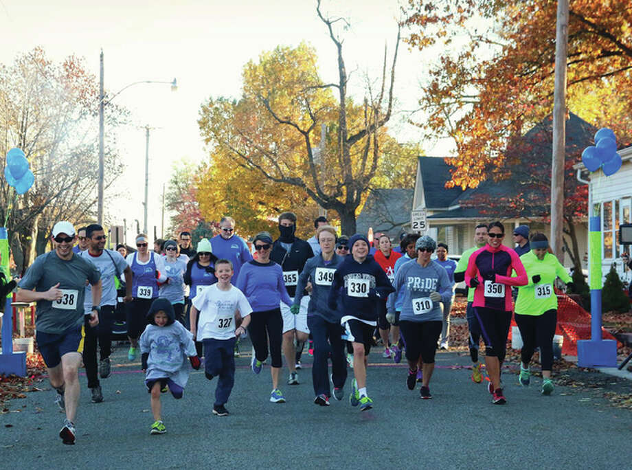Runners start last year's annual Givin' It All for Guts 5K run/walk in Bethalto. Photo: Marisa Woolsey/For The Telegraph