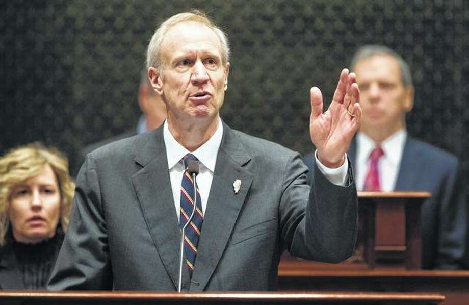 In this Jan. 25 file photo, Gov. Bruce Rauner speaks in the Illinois House chamber in Springfield. Already holding the title for longest state budget stalemate, Illinois is poised to enter a third year without a spending plan as the feud between Republican Gov. Rauner and Democrats controlling the Legislature drags on. They're expected to return to Springfield for a special session starting today, facing higher stakes to get a budget for the fiscal year that begins July 1. Ted Schurter | The State Journal-Register via AP, File
