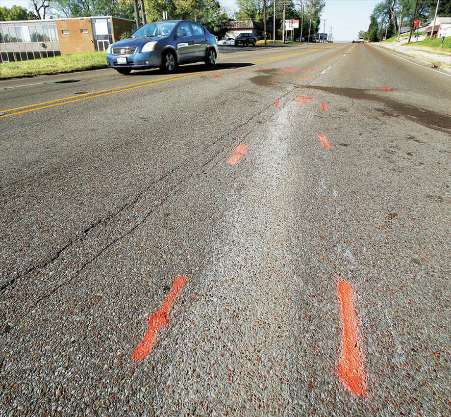 Police paint marks the track of the path of a head-on crash Saturday night on East Broadway at Brookside in Alton. Alton firefighters were on the scene of the crash for more than one hour and treated several people, including at least two children. Photo: John Badman|The Telegraph