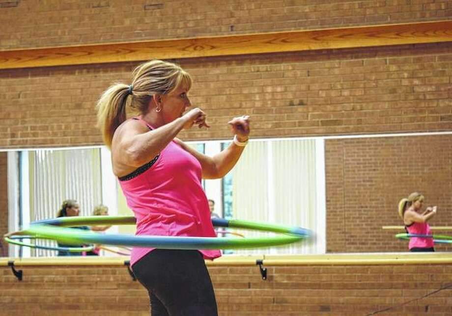 Shelly Hannant, hula hoop instructor at Bob Freesen YMCA, teaches her class. Photo: Greg Olson | Journal-Courier
