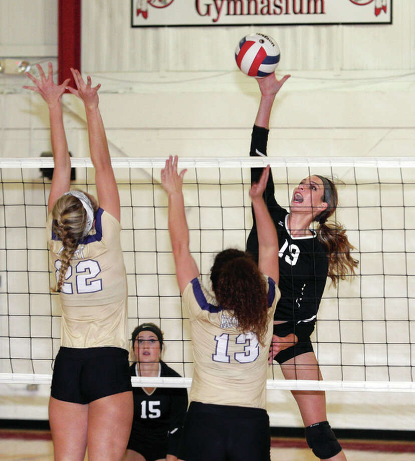 Calhoun senior Grace Baalman (13) had 20 kills in Tuesday night's 1A regional victory over Carrollton. She is shown in action earlier this season against Jacksonville Routt. Photo: Telegraph File Photo