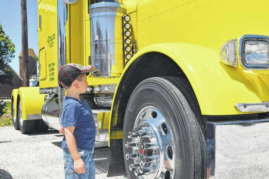 Grady Kennedy, 5, looks at a 2007 Peterbilt truck owned by his cousin Derek Flynn of Winchester. It was one of about 45 semi trucks on display Saturday at the sixth annual Jacksonville Semi Truck and Trailer Show on the Prairie Land Heritage Museum grounds in South Jacksonville. Grady is the son of Chris and Tahni Kennedy of Barry.
