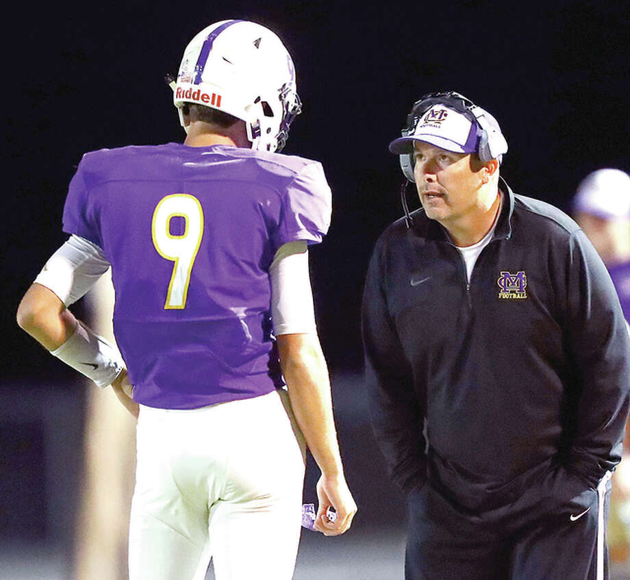 Civic Memorial head coach Mike Parmentier, right, talks with quarterback Braydon Pierce during a game against Waterloo this season in Bethalto. Photo: Billy Hurst File Photo | For The Telegraph