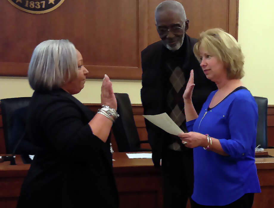 ALTON — Tammy Smith, a longtime friend of late Alderwoman Alice Martin, is sworn in to fill her aldermanic seat Wednesday night with the blessing of Martin's widower, Doug Sr. City Clerk Mary Boulds, flanked by Doug Martin in front of the chambers, swore in Smith.