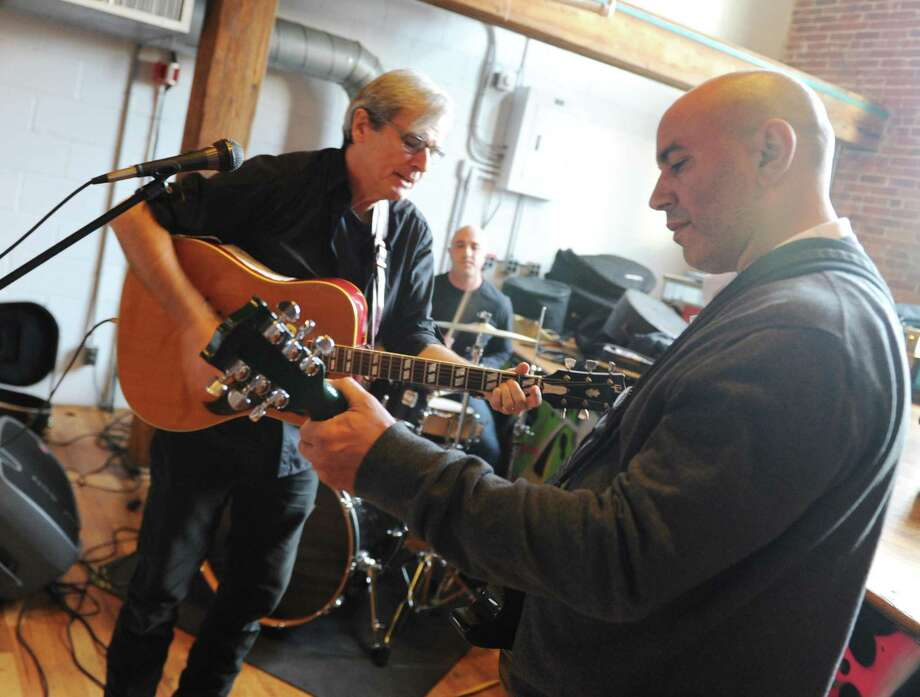 Guitarists Nick Carter, left, and Andre Soto rehearse with drummer Felix Guiffra at the Arch Street Teen Center in Greenwich, Conn. Wednesday, Jan. 31, 2018. Local residents have been hosting monthly open mic nights in an effort to bring live music back to the Teen Center. The next open mic will be Feb. 18 from 6 p.m. to 11 p.m. Photo: Tyler Sizemore / Hearst Connecticut Media / Greenwich Time