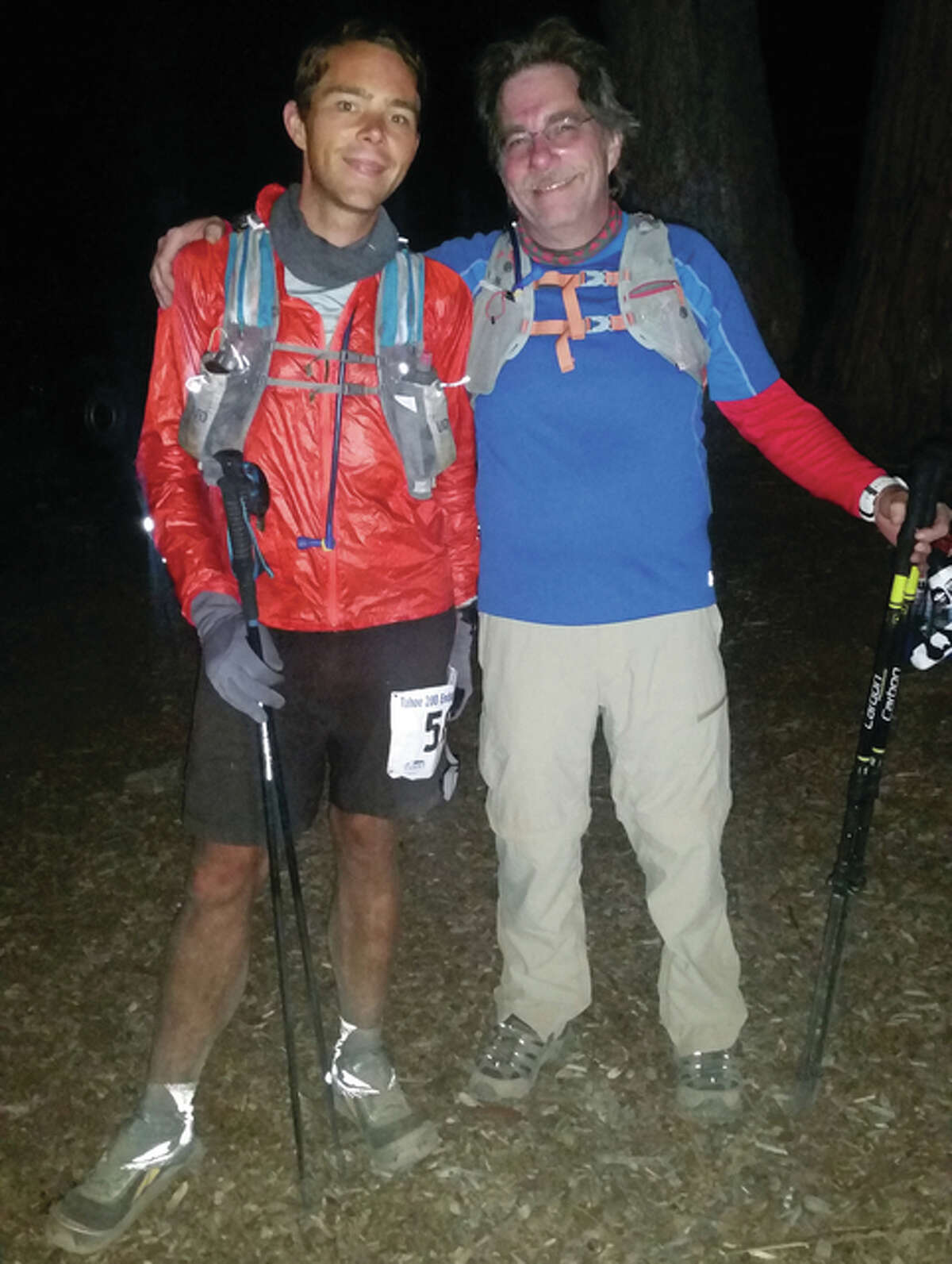 Justin Galbraith, an Alton High School graduate, poses for a photo with his father, Bill Galbraith, right after Justin finished the Tahoe-200, a 205-mile running race around Lake Tahoe. He completed the race is 85 hours with very little sleep.