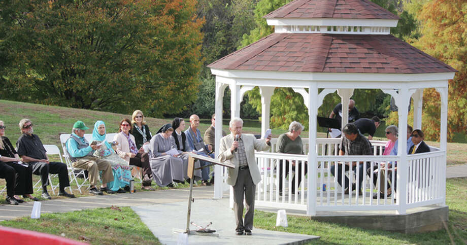 Charles Sheppard emcees the rededication of the Oriental Garden at Gordon F. Moore Community Park Saturday afternoon.