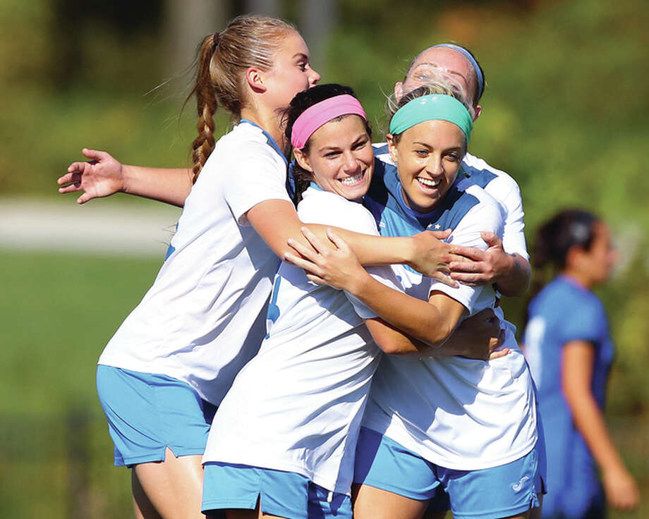 LCCC's Emily Cardwell (center) and teammates celebrate a goal during Thursday's Region 24 semifinal win over Southwestern Illinois College in Godfrey. From left is Nina Breuer, Cardwell, and Kyleigh Kristensen. Cardwell, a scholarship softball player at LC, joined the soccer team seven games into the season and has scored 13 goals. Photo: Billy Hurst | For The Telegraph
