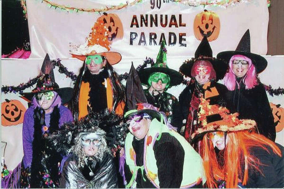 "The witches in front of their 1990 float, ""Best Witches."" Bottom row from left, Karen Taylor, Susie Bensman-Logsdon and Sheila Segraves. Top row from left, Mary Ellen Schwaab, Vickie Kelly, Shirlee Kauble, Becky Allen and Connie Bond."