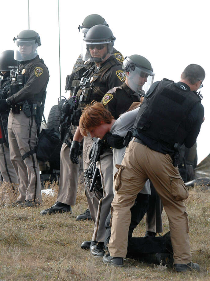 An unidentified Dakota Access Pipeline protester is arrested inside the Front Line Camp as law enforcement surround the camp to remove the protesters from the property and relocated to the overflow camp a few miles south of Highway 1806 in Morton County, North Dakota, Thursday, Oct. 27.