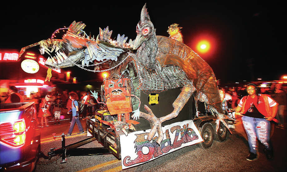 Birdzilla, a float from the Alton Middle School art students, makes its way down East Broadway Monday night in the 100th annual Alton Halloween Parade. Thousands turned out with excellent weather.