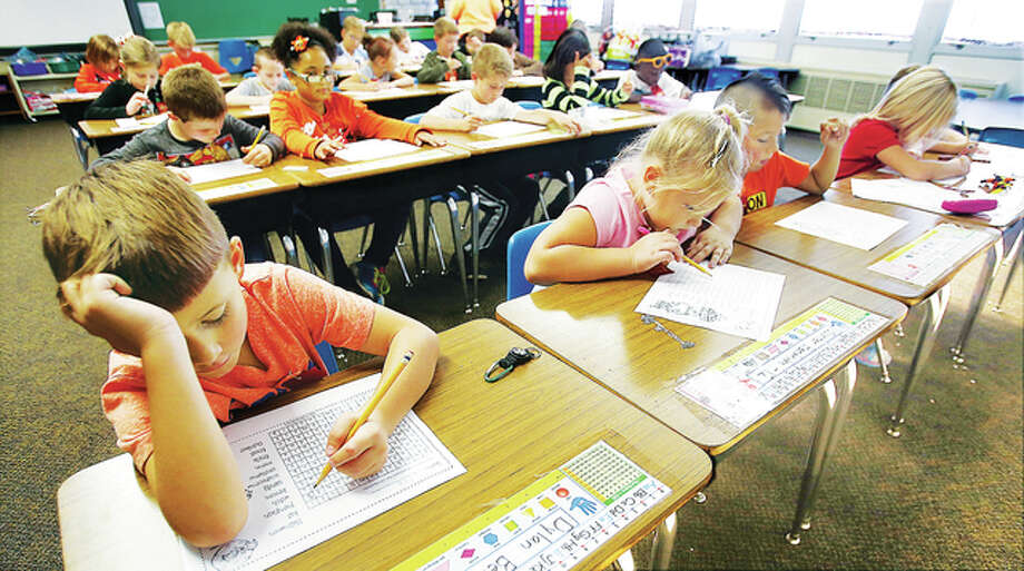 Second grade students in the classroom of teacher Sheryl Ross work at their desks Monday at Lewis and Clark Elementary School in Wood River.