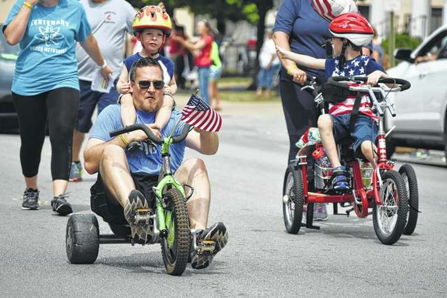 Tricyclists make their way down West Main Street during the Jacksonville Fourth of July Parade on Tuesday. Photo: Nick Draper | Journal-Courier