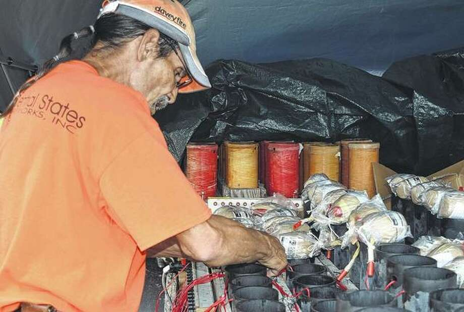 John Majzel, a lead pyrotechnic with Central States Fireworks, sets up the fireworks for the Franklin fireworks display Wednesday at the Franklin High School baseball field. Photo: Samantha McDaniel-Ogletree | Journal-Courier