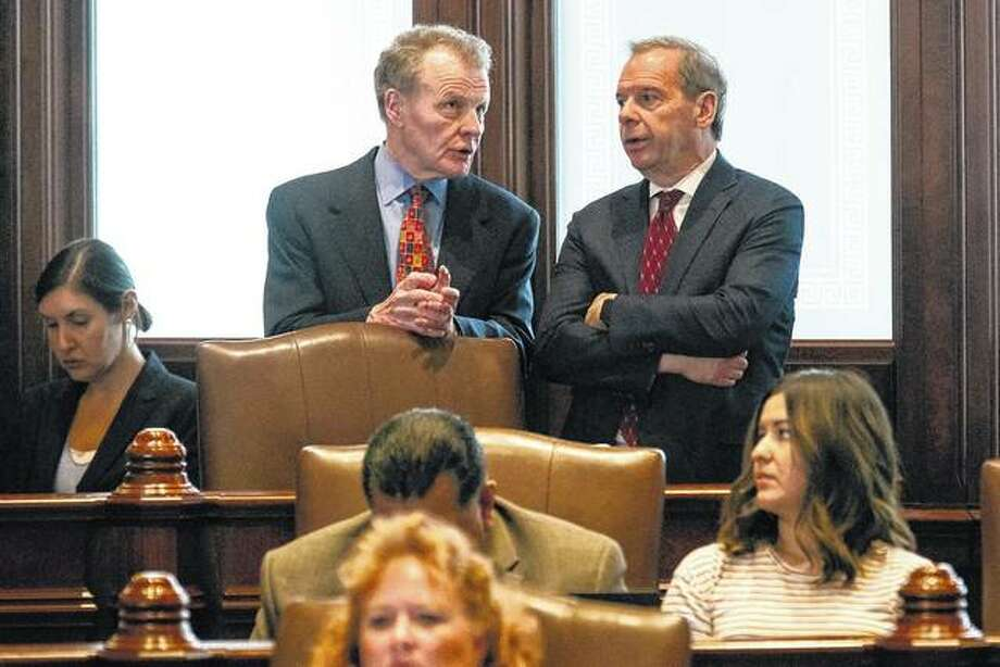 House Speaker Michael Madigan (left) and Senate President John Cullerton talk on the Senate floor Tuesday at the Capitol in Springfield. The Illinois Senate OK'd an annual spending plan of $36 billion following a critical vote to raise the income tax rate and overrode a veto by Gov. Bruce Rauner. The House is scheduled to consider a veto override today.