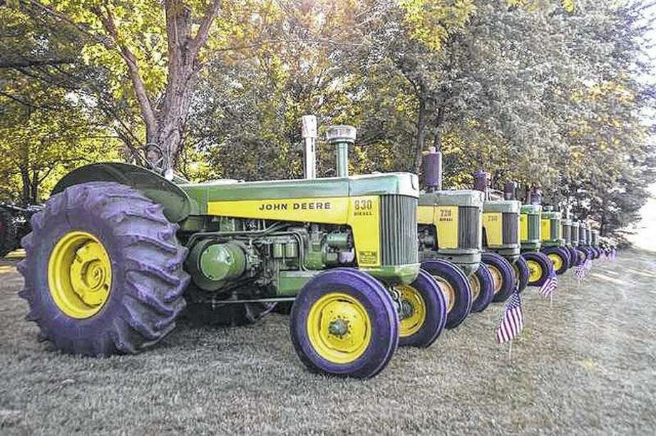 A seemingly never-ending row of John Deere tractors is lined up in Franklin during Fourth of July events.