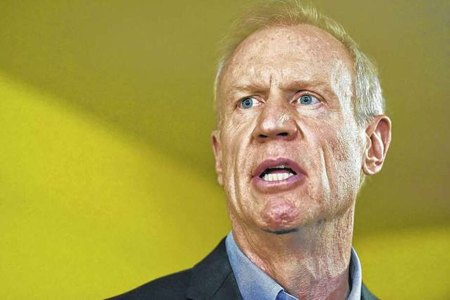 Gov. Bruce Rauner speaks during a news conference Wednesday after he vetoed a package of legislation that raised the income tax by a permanent 32 percent to finance a $36 billion spending plan, which would be Illinois' first budget since 2015. Photo: G-Jun Yam | AP