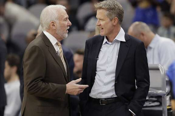 San Antonio Spurs head coach Gregg Popovich, left, and Golden State Warriors head coach Steve Kerr, right, visit before an NBA basketball game, Thursday, Nov. 2, 2017, in San Antonio. (AP Photo/Eric Gay)