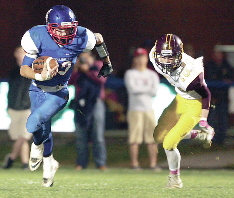 Carlinville's Blake Richardson, left, and his Cavaliers teammates will play host to Williamsville in a second-round playoff game Saturday. Richardson and EA-WR's Christian Hunter are shown in the Cavies' first-round win last week. Photo: James B. Ritter | For The Telegraph