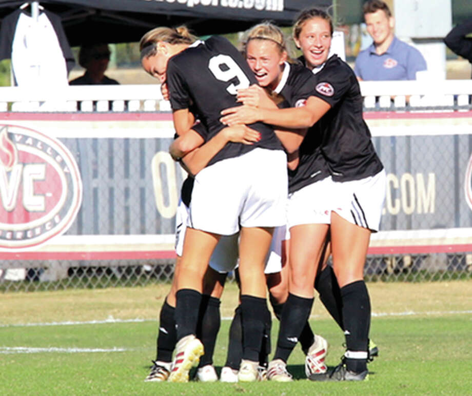 Members of the SIUE women's soccer team, including Caroline Hoefert (9), celebrate the winning goal Friday against Murray State University in SIUE's 23-1 overtime win in Murray, Ky. Hoefert, a graduate of Marquette Catholic High, assisted on both SIUE goals. Photo: SIUE Athletics