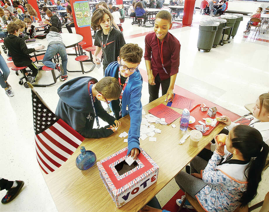 Sixth grade students cast their votes Friday in a mock election for the U.S. presidency in the school cafeteria during their lunch period in the Annex Building at Alton Middle School. The entire school and staff were afforded the privilege of a democracy by being able to pick, at least by name, their choice for the next president of the United States.