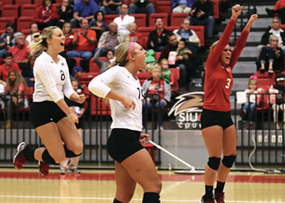SIUE's (from left) Tessa Amsden, Mallory Mangun and Katie Shashack celebrate a point in the Cougars' 3-1 victory over Southeast Missouri on Friday night at Vadalabene Center in Edwardsville. Photo: SIUE Athletics