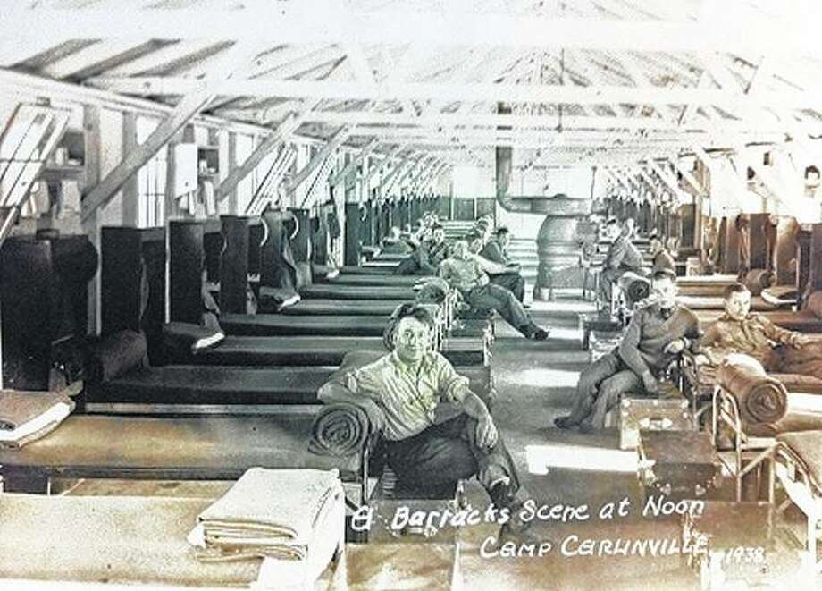 Men relax in the barracks of the Civilian Conservation Corps camp near Carlinville. The CCC offered quasi-military living, including spartan barracks, a mess hall, infirmary and recreation facilities.